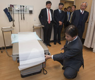 man inspecting exam table