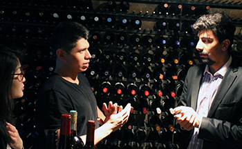 Nancy Sun and Dan Dobras receive an impromptu lecture from Kevin Kremer, head sommelier at the Bocanáriz restaurant in downtown Santiago.