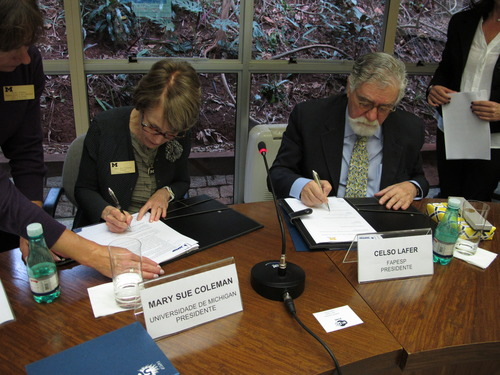 President Mary Sue Coleman signs agreement for grant program in Brazil.