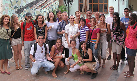 A photo of Ruth Behar leading a student tour of Cuba.