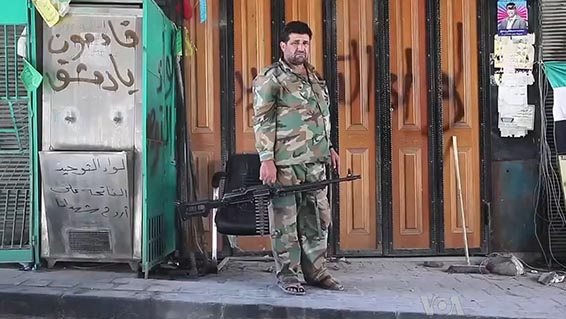 A Free Syrian Army soldier with a machine gun in the northwestern city of Aleppo.