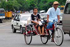 A rickshaw navigates traffic in Burma. (Photo by Jon Keesecker)
