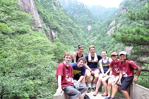 The author (far right) taking a rest at a scenic spot on Huangshan.