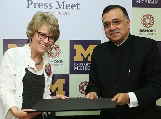 U-M President Mary Sue Coleman and Pramath Raj Sinha of Ashoka University celebrate a new partnership.