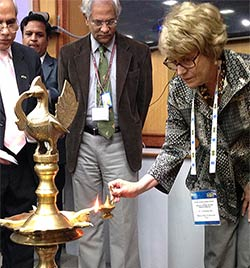 U-M President Mary Sue Coleman lights a lamp with other dignitaries - a common ritual in India that pays tribute to Saraswati, the goddess of knowledge.