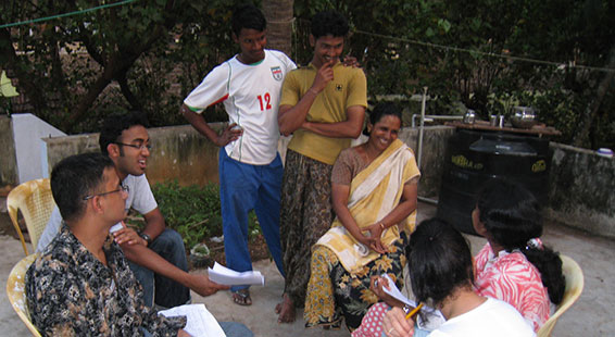 Migrants are interviewed about personal finance issues. (Courtesy Dean Yang)