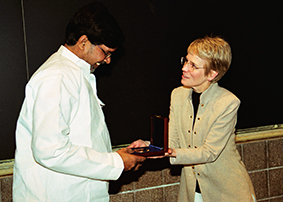 Satyarthi receives the Wallenberg Medal from then President Mary Sue Coleman.