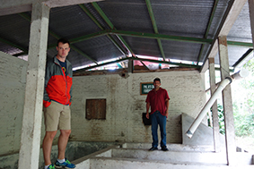 Marvin and Will inspect the cooperative's washing station, a crucial step in processing coffee.