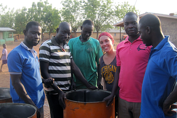 U-M alumna and Peace Corps volunteer Genevieve James gathers with teachers at an incinerator they built for the primary school in her community in northern Ghana. (Credit: Peace Corps)