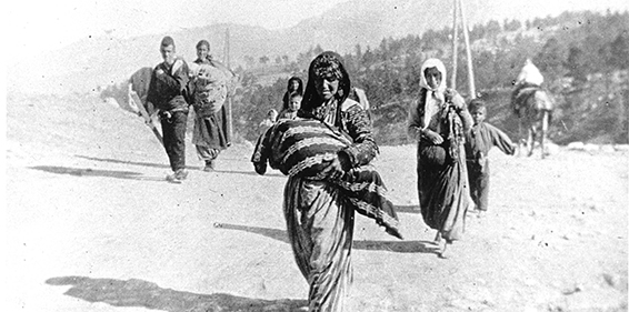 Armenian refugees carrying few belongings in 1915 in the Syrian region of the Ottoman Empire.  (Credit: Armenian National Institute, Inc., courtesy of Sybil Stevens, the daughter of Armin T. Wegner) Wegner Collection, Deutches Literaturarchiv, Marbach & United States Holocaust Memorial Museum.