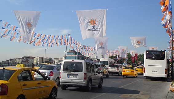 Campaign banners for the AKP, the ruling party, whose symbol is the light bulb, are displayed in Instanbul.  (Credit: Christiane Gruber)