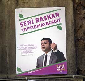 "A poster of Selahattin Demirtas, the co-leader of the HDP (Peoples' Democratic Party). The slogan above him is directed toward President Erdogan and says, ""We won't make you president!"""