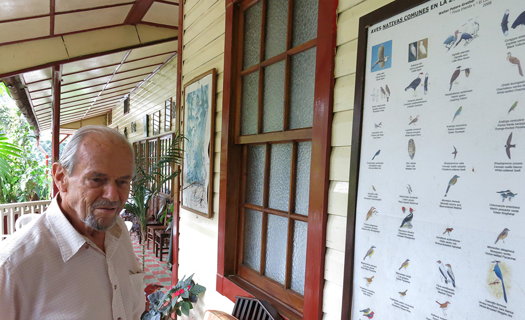 Bird posters decorate the home of Walter Peters, whose passion for wildlife inspires his commitment to growing organic coffee at Finca Irlanda.