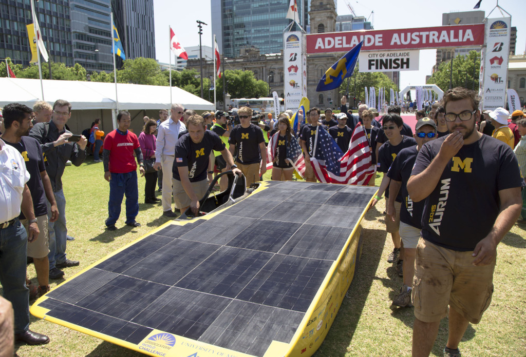 The U-M Solar Car Team celebrates its fourth place finish in Adelaide at the finish of the 2015 Bridgestone World Solar Challenge. Photo: Evan Dougherty, Michigan Engineering Communications & Marketing http://dme.engin.umich.edu/solarcar25