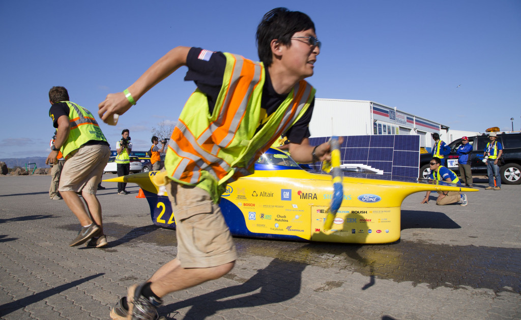 The U-M Solar Car Team charges at a mandatory control stop in Port Wakefield on day four of the 2015 World Solar Challenge. (Credit: Evan Dougherty, Michigan Engineering Communications & Marketing) http://dme.engin.umich.edu/solarcar25