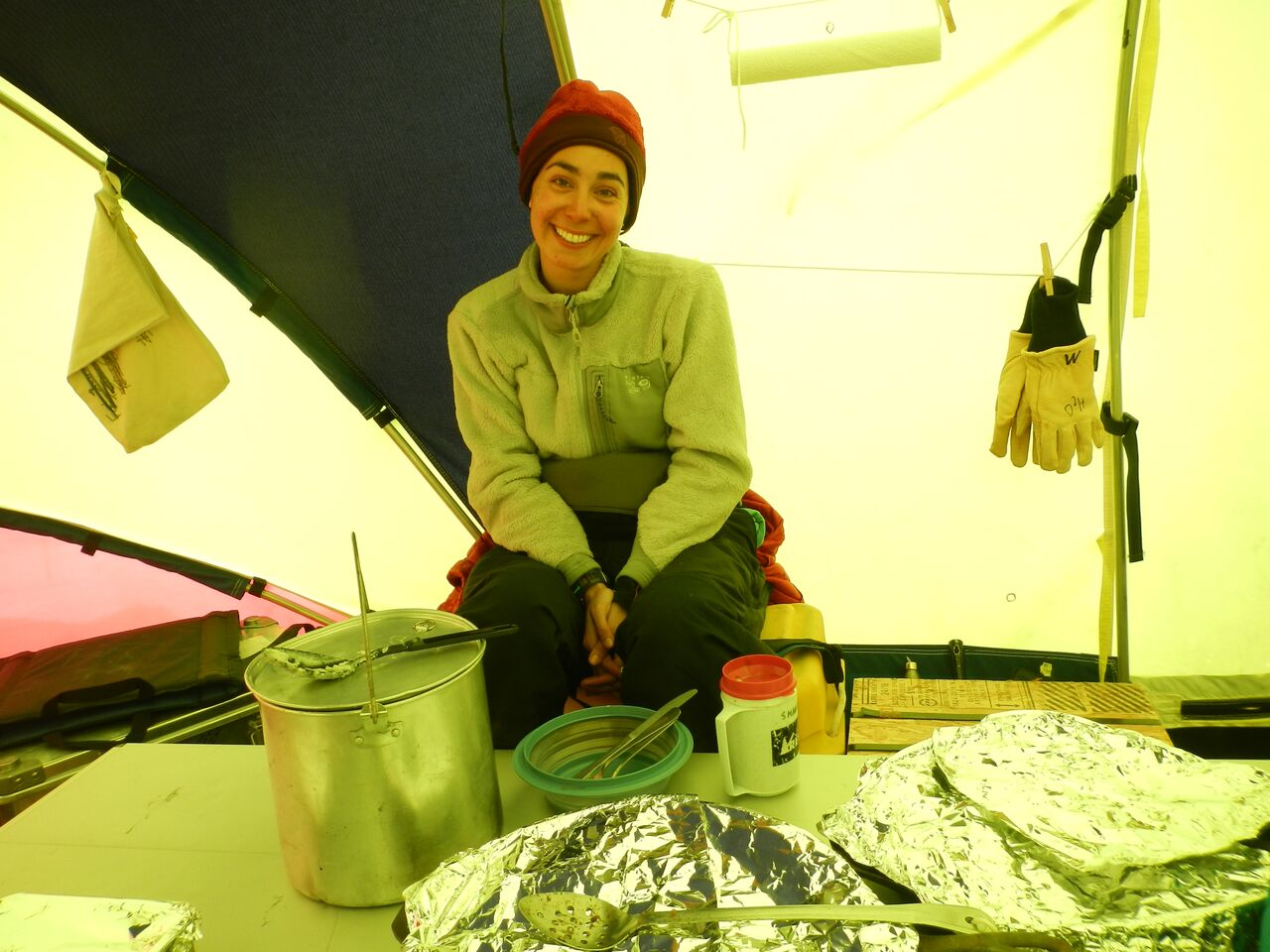 Graduate student Sarah Aarons relaxes in the cook tent on Taylor Glacier. (Photo by Sarah Aciego)