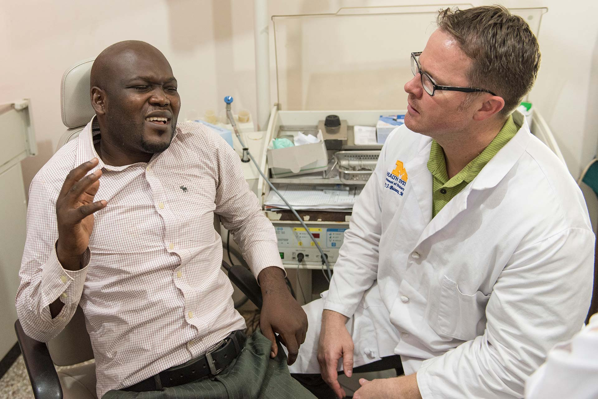 John Obeng explains his symptoms to Dr. Greg Basura
