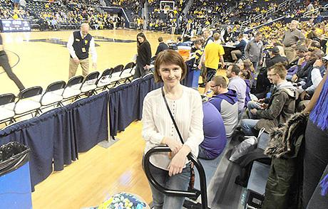 Olena Strelnyk, a visiting scholar from Ukraine, attends a basketball game at Crisler Center. (Photo courtesy of Olena Strelnyk)