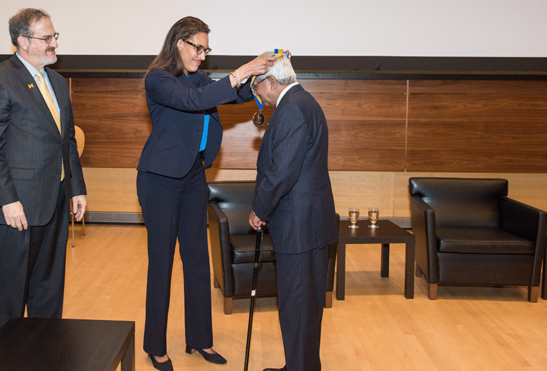 U-M President Mark Schlissel watches as Regent Shauna Ryder Diggs awards the Francis Medal to Sir Fazle Hasan Abed.