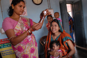 1280px-Community_health_worker_gives_a_vaccination_in_Odisha_state,_India_(8380317750)