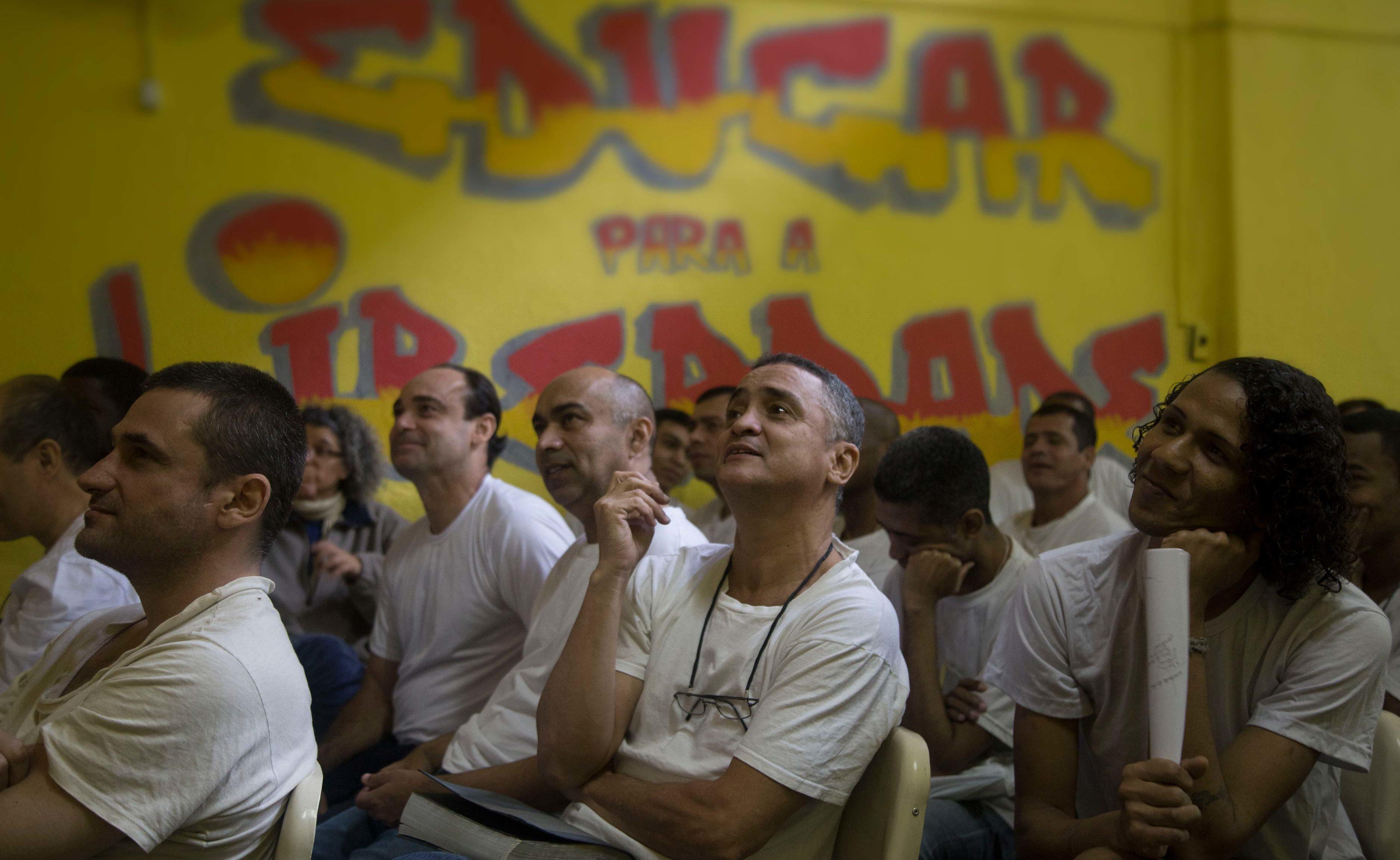 Prisoners at a men's penitentiary in Rio de Janeiro, Brazil, watch a performance by U-M associate professor Ashley Lucas. Photo: Levi Stroud