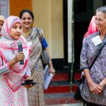 A girl from FCAB welcomes University of Michigan School of Public Health delegates to Bagdumur, a village 4 hours away from the capital Dhaka.