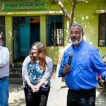 SPH Dean Martin Philbert speaks to the villagers of Bagdumur. On his left are SPH faculty Elizabeth King and Matt Boulton.
