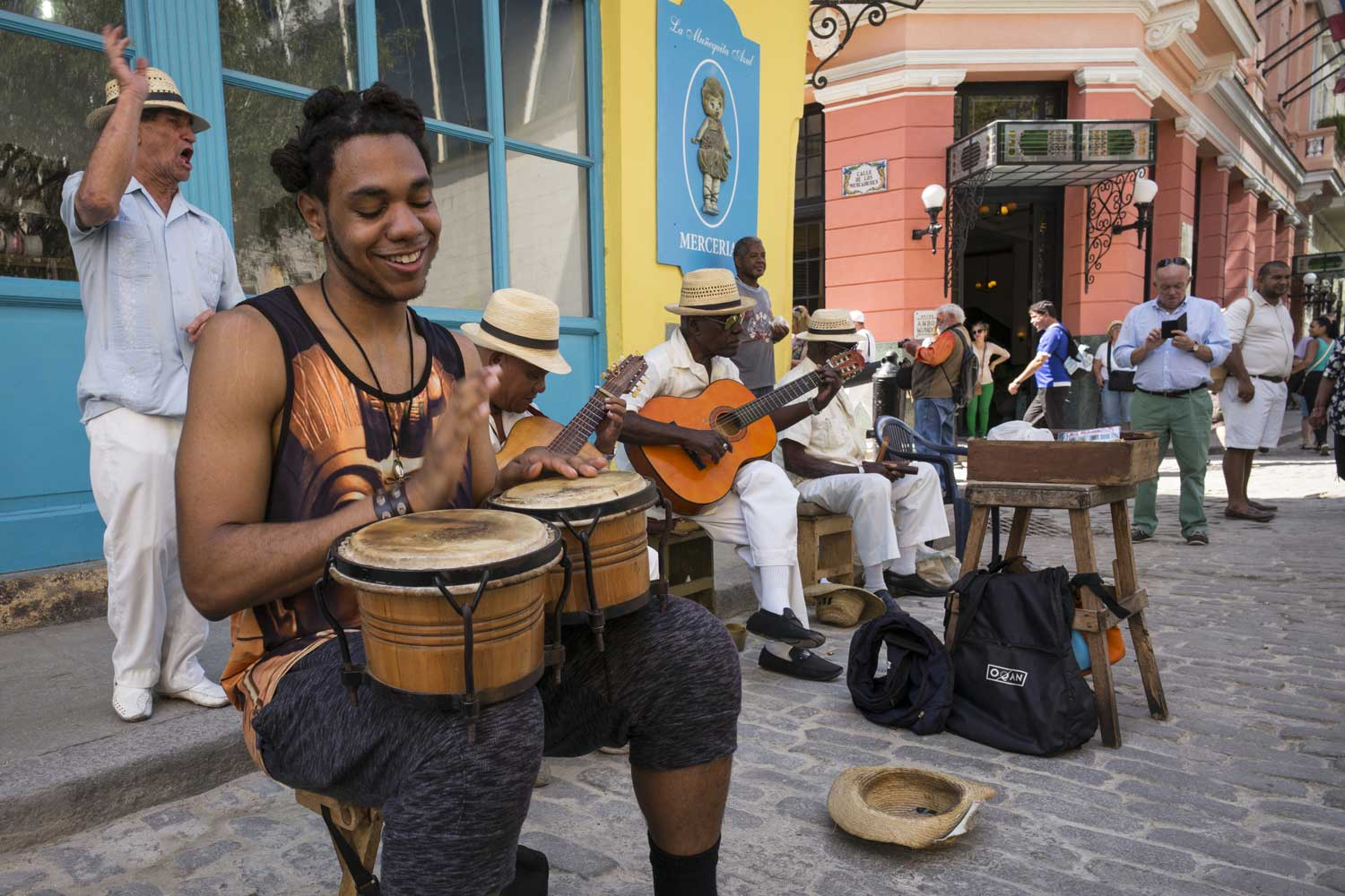 Student Michael Gardner plays bongos with a street band in Havana