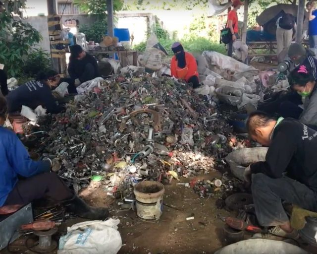 Some e-waste recyclers focus on taking fans apart in Thailand, separating metal and plastic components for resale.