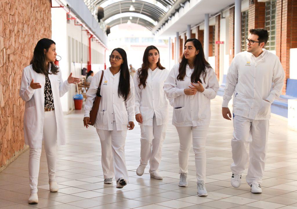 U-M students walking through hall of University of Sao Paulo, in Bauru on a tour.