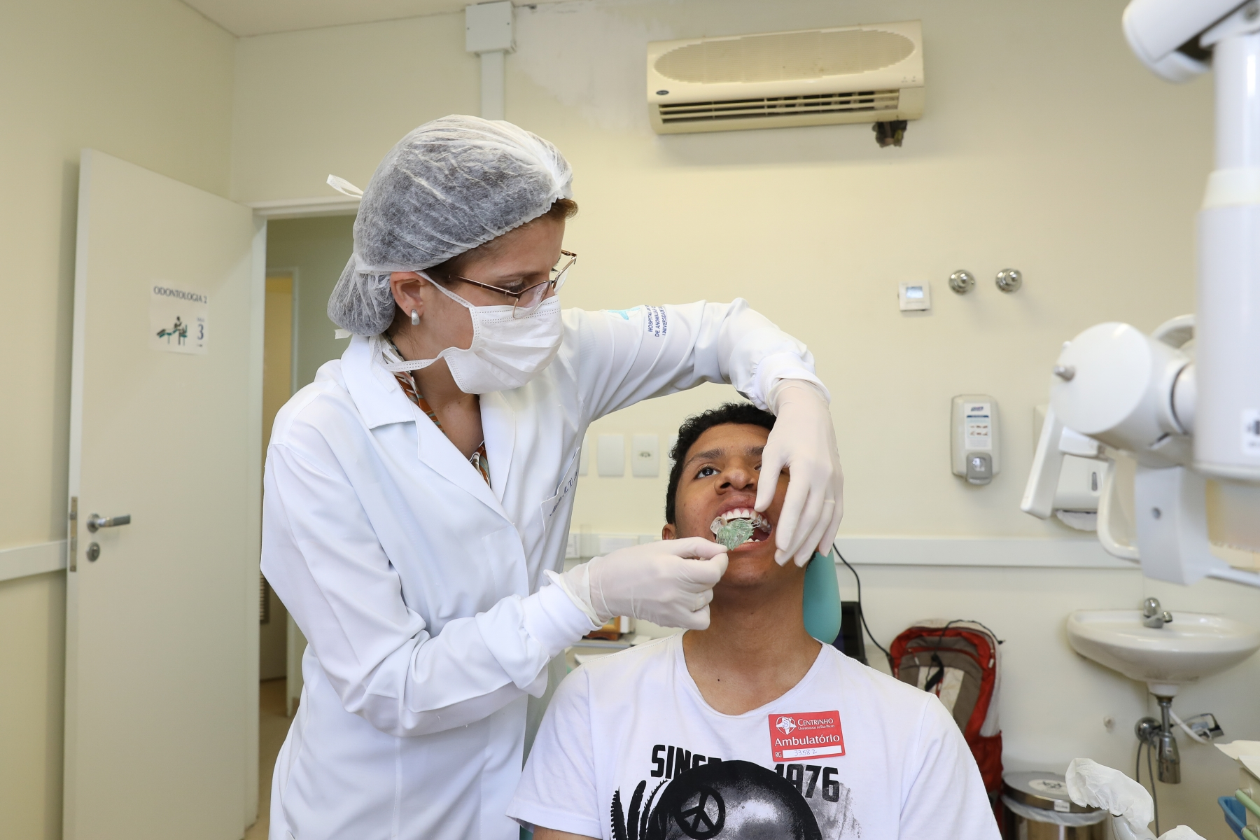 Patient gets prosthesis' adjustment by dentist in dental office