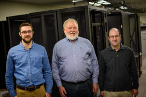 John Traylor, Edward Happ and Michael Hess make up the team behind the Crisis Informatics Lab, which teaches students how to solve problems in disaster situations without access to certain technologies (photo by Jeffrey Smith).