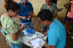 Study personnel prepare to collect blood samples from children in a neighborhood in Managua in June 2017 as part of the Nicaraguan Pediatric Dengue Cohort Study (PDCS), a long-standing pediatric dengue cohort established in 2004. Image credit: Sustainable Sciences Institute, Paolo Harris Paz