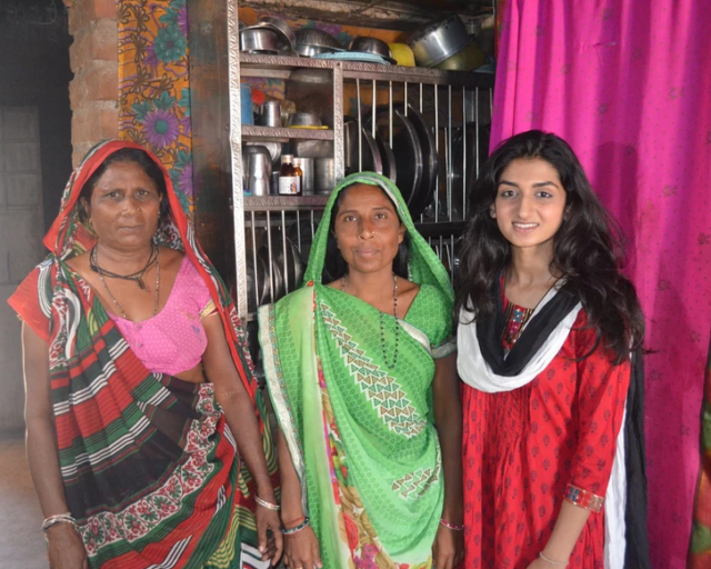 Patel, pictured farthest to the right, with two local women.