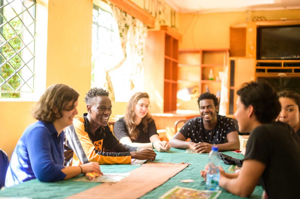 U-M Engineering students meet with Kevin Mwendi, who has recently been accepted to university for engineering, at his home the Kithoka Amani Children's Home in Meru, Kenya