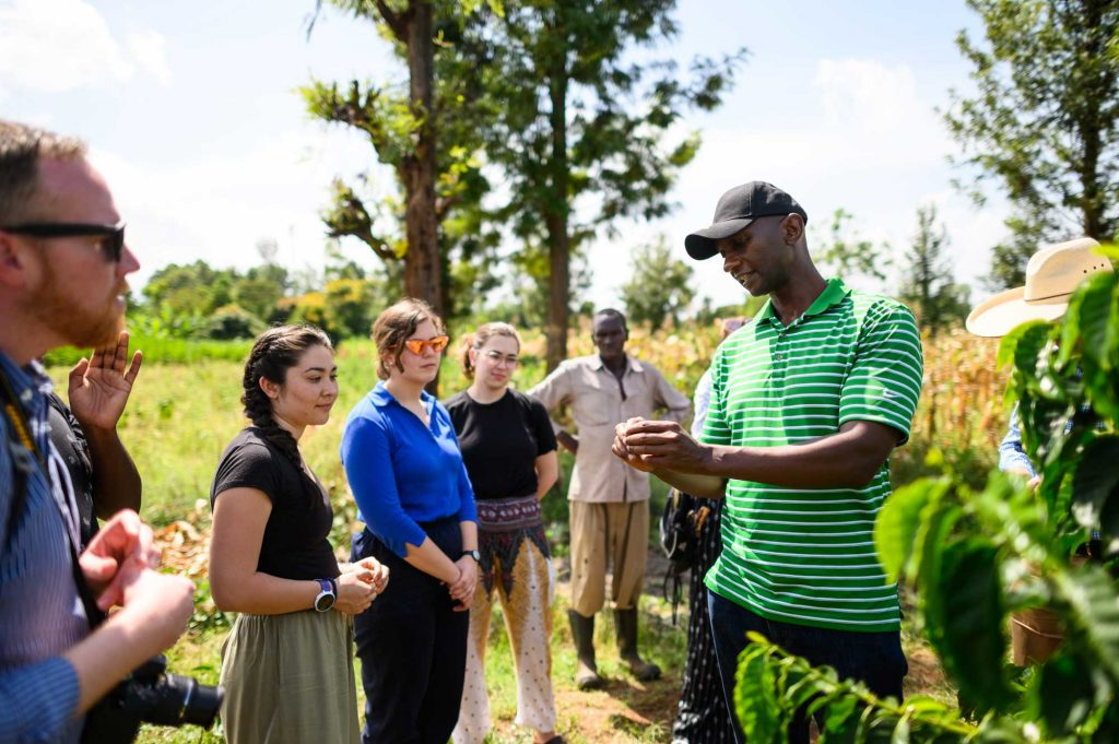 Mutai Kinyua and U-M Engineering students at DeMan Coffee plantation in Nkubu, Kenya.