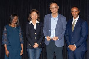 Dowson Tong receiving Michigan Engineering's 2018 Electrical & Computer Engineering Alumni Merit Award.