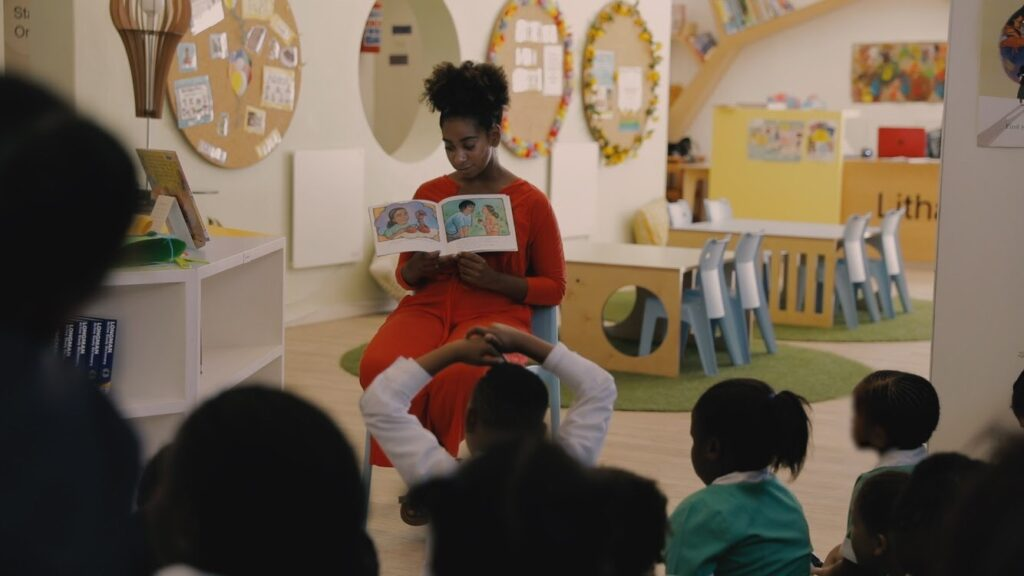 Fellow Adelia Davis reads for the kids in South Africa. Photo by Chris Duncan