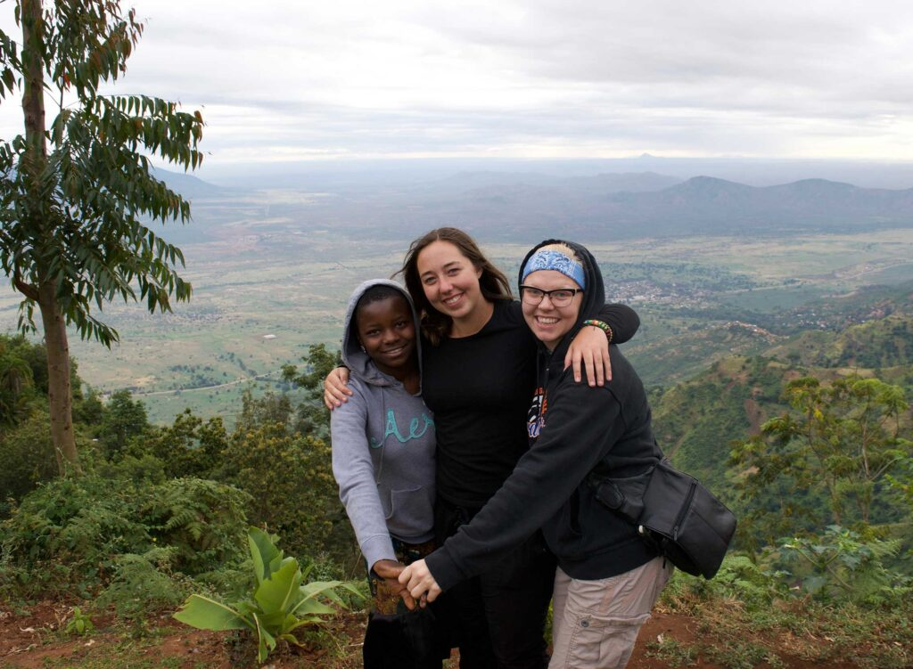 Fellow Meagan Malm (center) with some friends in Tanzania.