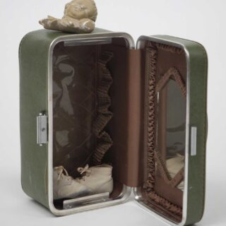 Green suitcase sculpture