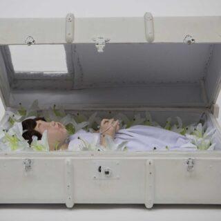 White suitcase sculpture