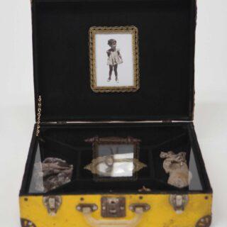 Yellow suitcase sculpture