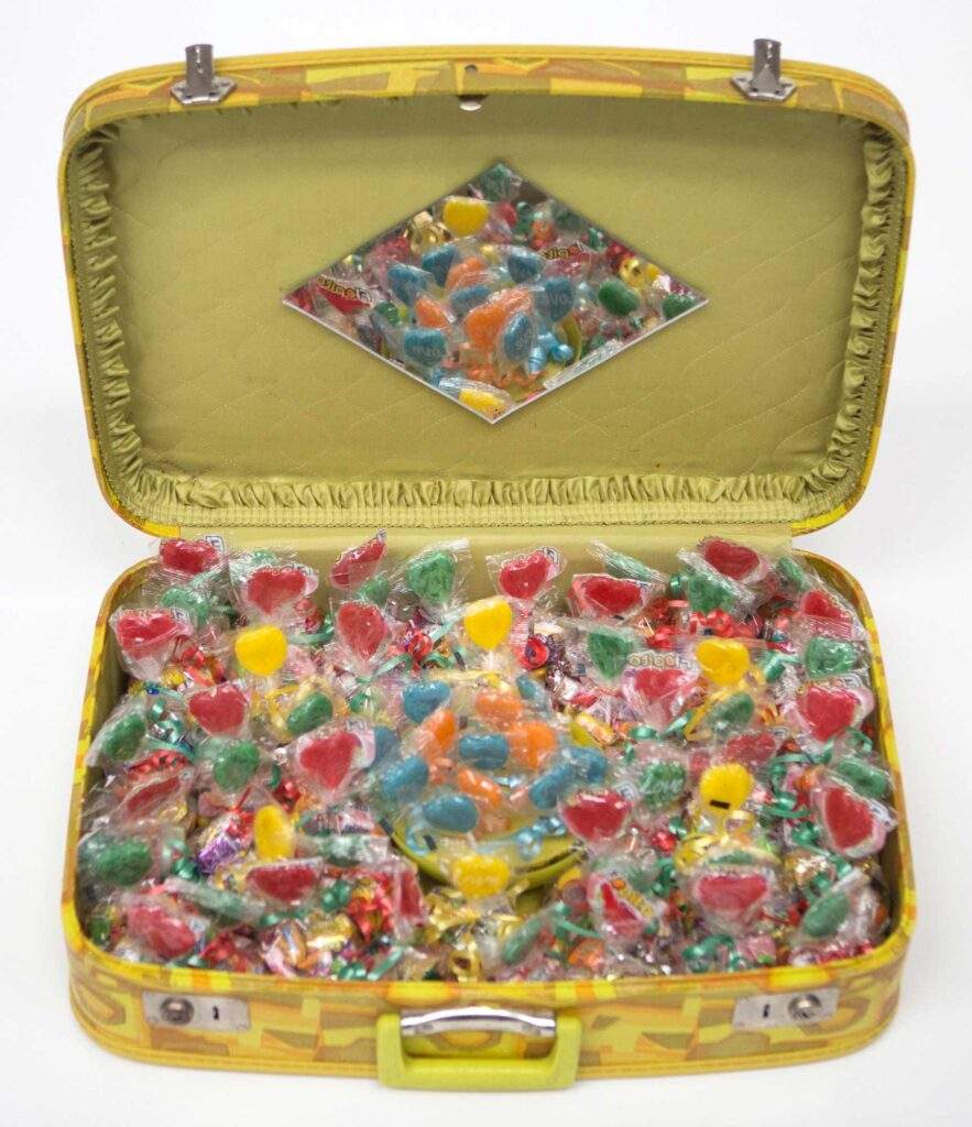 Yellow suitcase with candy