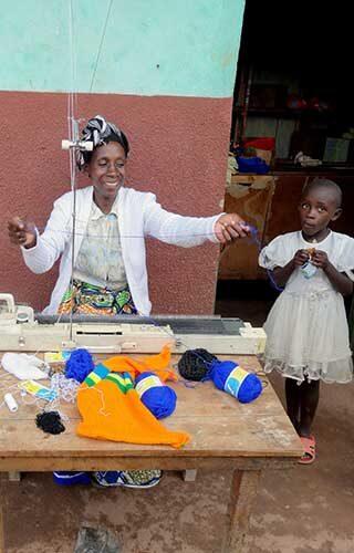 A sweater maker in Rwanda. Photo by Anna Chan.