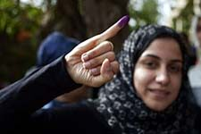 A voter in Egypt shows she cast a ballot.