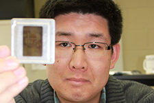 Doctoral student Joseph Ho collects images shot by missionaries in China.