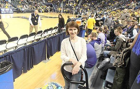 Olena Strelnyk, a visiting scholar from Ukraine, attends a basketball game at Crisler Center. (Photo courtesy of Olena Strelnyk)