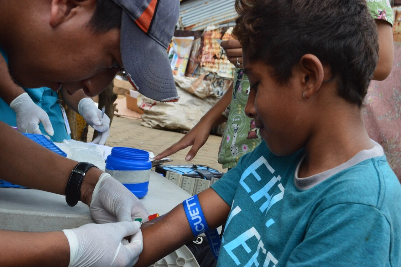 Study personnel collect samples in a neighborhood in Managua in June 2017 from participants in the Nicaraguan Pediatric Dengue Cohort Study (PDCS), a long-standing pediatric dengue cohort established in 2004. Image credit: Sustainable Sciences Institute, Paolo Harris Paz
